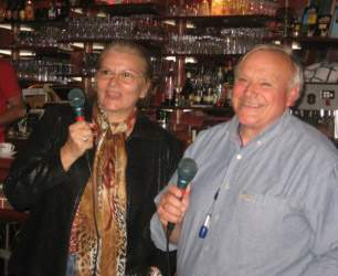 Man and woman doing karaoke